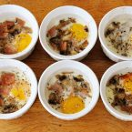 Traditional coddled eggs with bacon and mushrooms