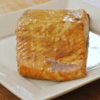 Fillet of sweet and spicy salmon on a white plate
