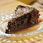 a slice of flourless chocolate cake on a plate