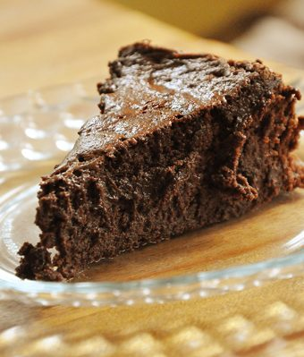 a slice of flourless chocolate cake on a plate