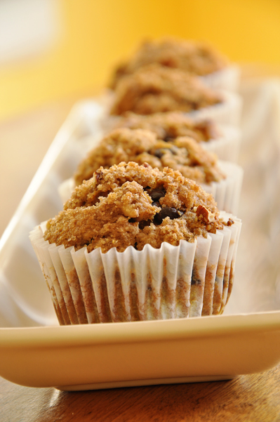 Whole Wheat Pumpkin Muffins make for a great snack. With a cinnamon streusel topping and chocolate chips you'd never believe this decadent treat is healthy. | livinglou.com