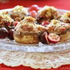 cranberry stuffed mushrooms on a crystal plate on a tuille napking