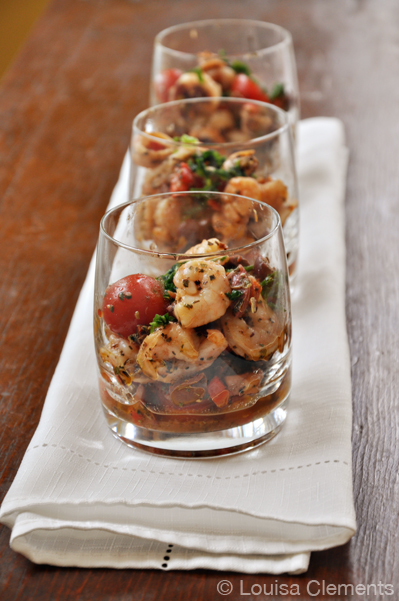 Seafood salad is the perfect make ahead appetizer for holiday entertaining. Plus it's healthy and loaded with tomatoes, basil, shrimp, mussels and scallops. | livinglou.com