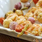 Cooked shrimp and vegetable skewers in a bowl