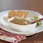 A bowl of melitzano salata with crackers