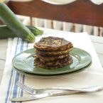A stack of zucchini fritters on a plate