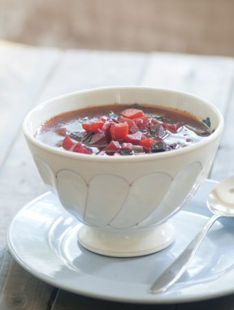A white bowl filled with borscht