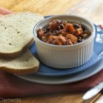 A bowl of vegetarian chili with two slices of sourdough bread