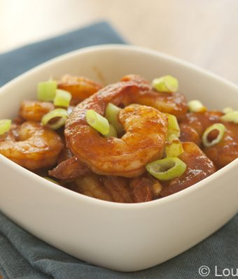 A bowl of shrimp with spicy garlic sauce