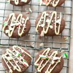 Chocolate cookies flavoured with peppermint and drizzle with white chocolate and crushed candy canes are the perfect holiday cookie.   livinglou.com