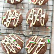 Chocolate cookies flavoured with peppermint and drizzle with white chocolate and crushed candy canes are the perfect holiday cookie. | livinglou.com