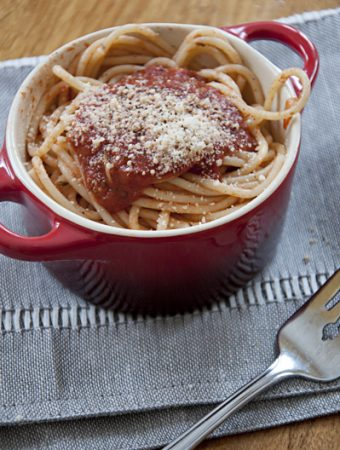 A bowl of easy spaghetti sauce topped with parmesan cheese