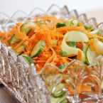 Carrot salad with cucumbers in a glass bowl