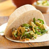 Get dinner on the table quickly with this simple recipe for slow cooker shredded chicken tacos. | livinglou.com