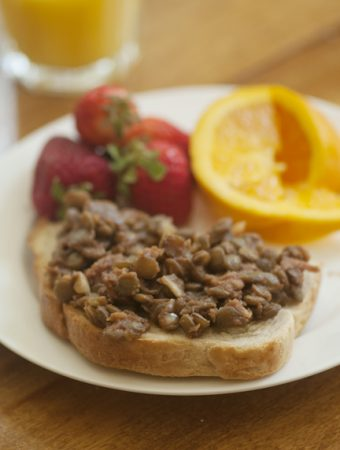 Baked lentils on toast are a healthy and protein packed breakfast inspired by the British favourite baked beans on toast. | livinglou.com