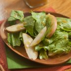 apple-cider-vinaigrette on lettuce greens with apple slices
