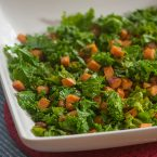 Sauteed kale with sweet potatoes in a white bowl
