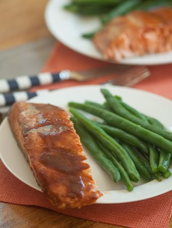 Asian-style barbecue roasted salmon on plate with green beans