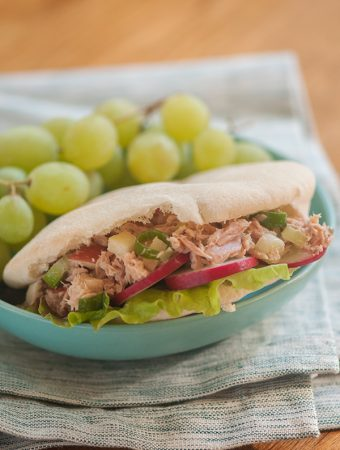 Tuna salad in pita pockets with grapes on the side