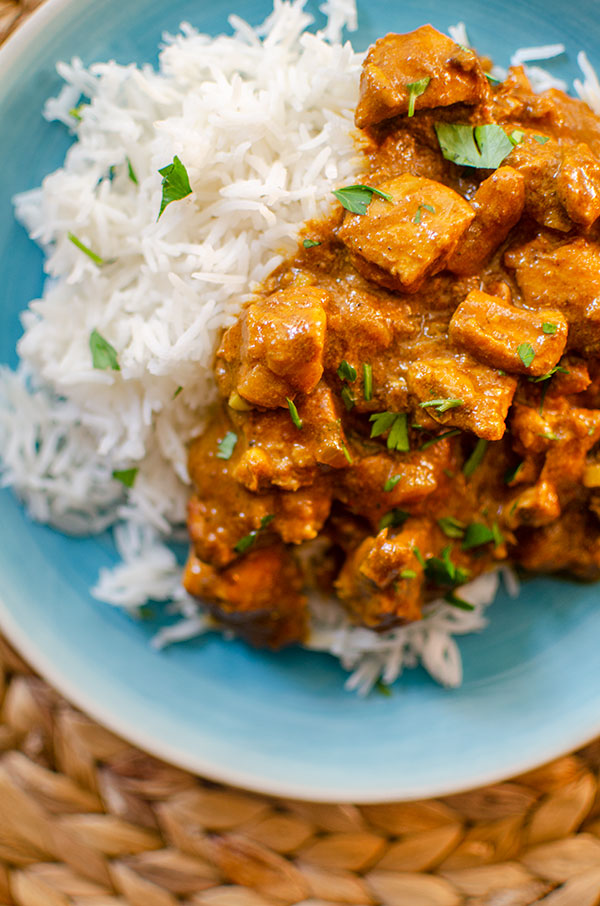 Closeup of slow cooker butter chicken with rice and cilantro