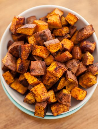 cinnamon chili roasted sweet potatoes in a bowl