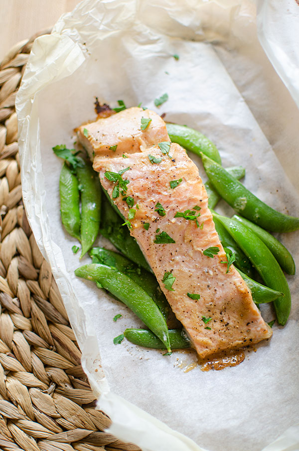 Finished miso salmon on top of sugar snap peas on parchment paper.