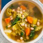 Packed with goodness, this healthy six vegetable white bean soup is elevated with the addition of pesto swirled in at the end! | Livinglou.com