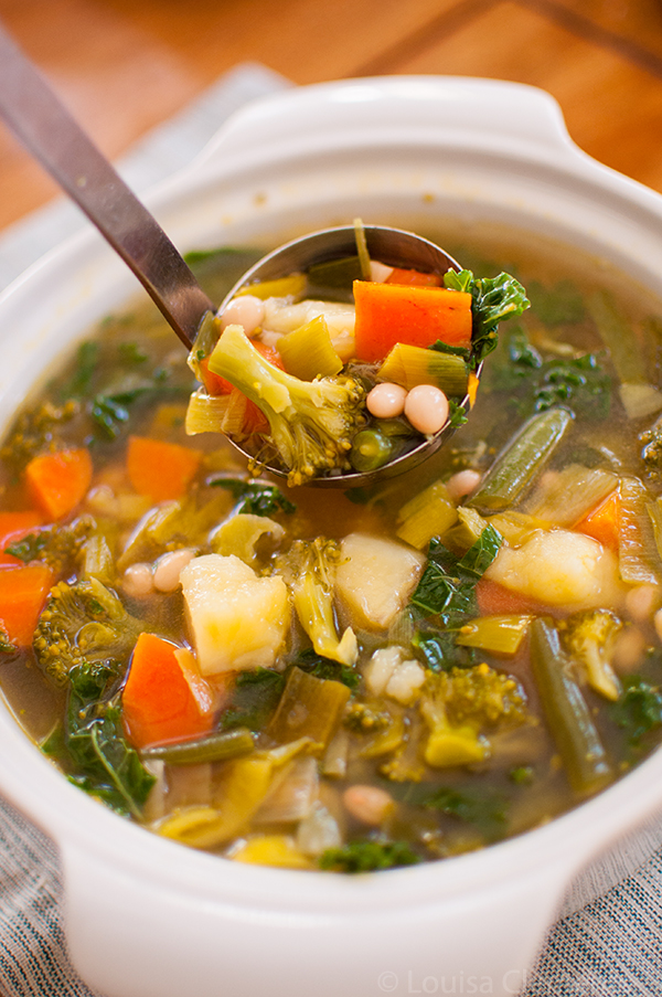 Packed with goodness, this healthy six vegetable white bean soup is elevated with the addition of pesto swirled in at the end!   Livinglou.com