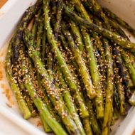 Grilled asparagus is a delicious side dish. Add some Asian flavour by tossing with a simple sesame dressing. | livinglou.com