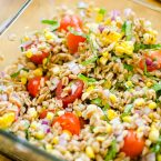 Charred corn and farro salad is packed with fresh basil and tomatoes for the perfect summer salad. | livinglou.com