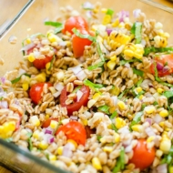 Charred corn and farro salad is packed with fresh basil and tomatoes for the perfect summer salad.   livinglou.com