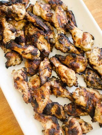 Add something new to your weekend barbecue with this simple recipe for greek grilled chicken wings. | livinglou.com