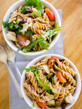 Mediterranean Pasta Salad with olive, sun dried tomatoes, artichokes and arugula. | www.livinglou.com