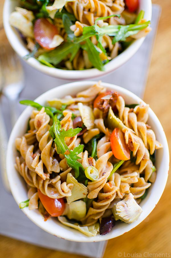 Mediterranean Pasta Salad with olives, sun dried tomatoes, artichokes and arugula. | www.livinglou.com
