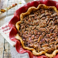 Combine two Thanksgiving pies into one with this layered pumpkin pecan pie. A spiced pumpkin pie layer on the bottom and gooey pecan pie layer on top.