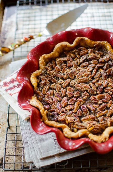 Combine everyone's two favourite pies for a decadent pumpkin pecan pie. The bottom layer is pumpkin and the top layer, a gooey pecan. | livinglou.com