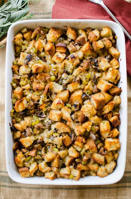 A fun twist on traditional holiday stuffing made with sourdough bread, sausage, leeks and apples, flavoured with fresh sage and rosemary. | livinglou.com