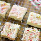 Peppermint cheesecake bars are the ultimate make-ahead potluck dessert. With an oreo base, white chocolate and crushed candy canes.   livinglou.com