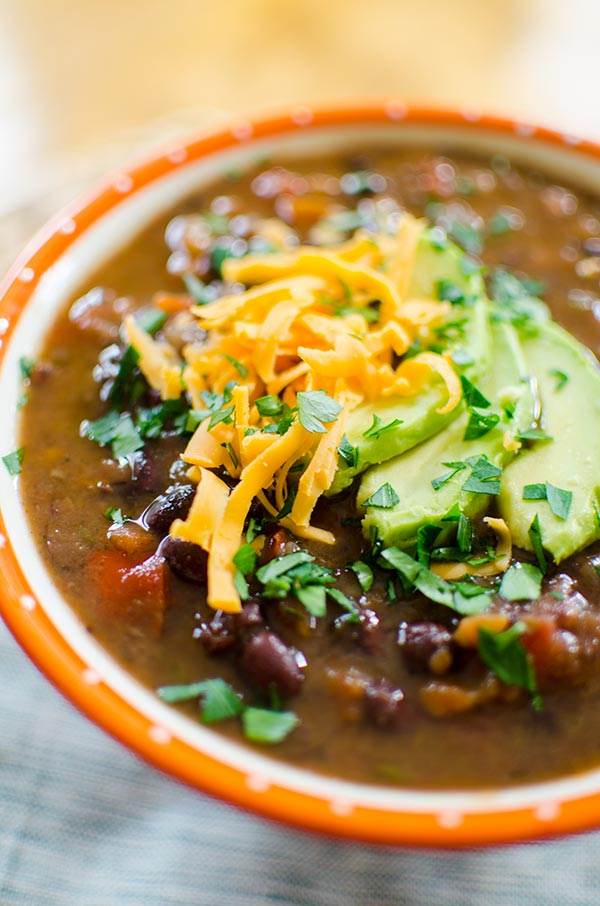 A healthy vegetarian soup recipe, this slow cooker black bean soup is so easy to make and loaded with spice, black beans and carrots. | livinglou.com