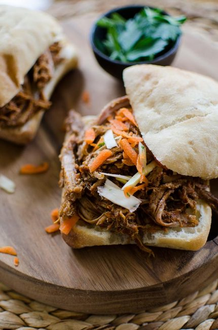 Make a big batch of slow cooker pulled pork with a healthy twist with carrots, pineapple juice and jalapeños. | livinglou.com