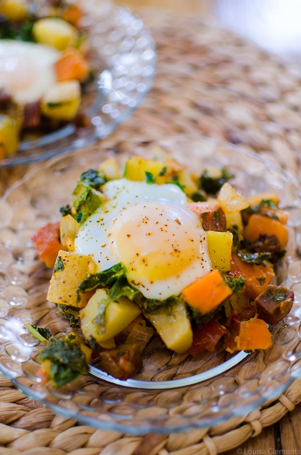 Start your day off on the right foot with this healthy breakfast recipe for kale and sweet potato hash with chorizo and eggs. | livinglou.com
