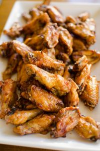Make your favourite wings in the oven with this crispy recipe for baked teriyaki chicken wings made with baking powder and a homemade teriyaki sauce. | livinglou.com