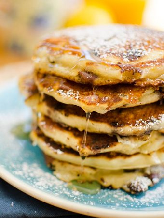 This recipe makes the best chocolate chip pancakes with a combination of milk chocolate, semisweet chocolate and white chocolate chips plus lemon zest. | livinglou.com