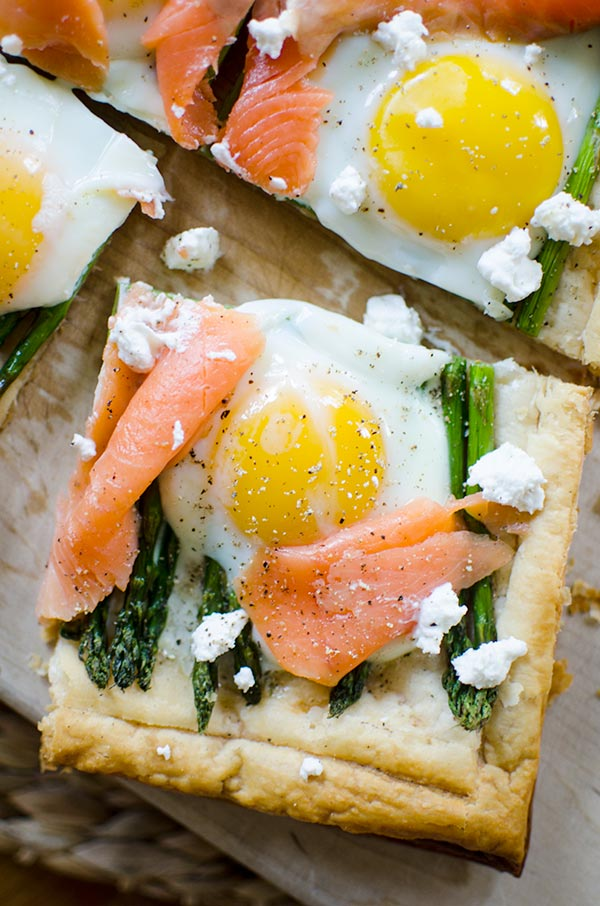 An impressive but simple brunch dish, this recipe for asparagus and egg tart with smoked salmon on a puff pastry crust will become a favourite. | livinglou.com