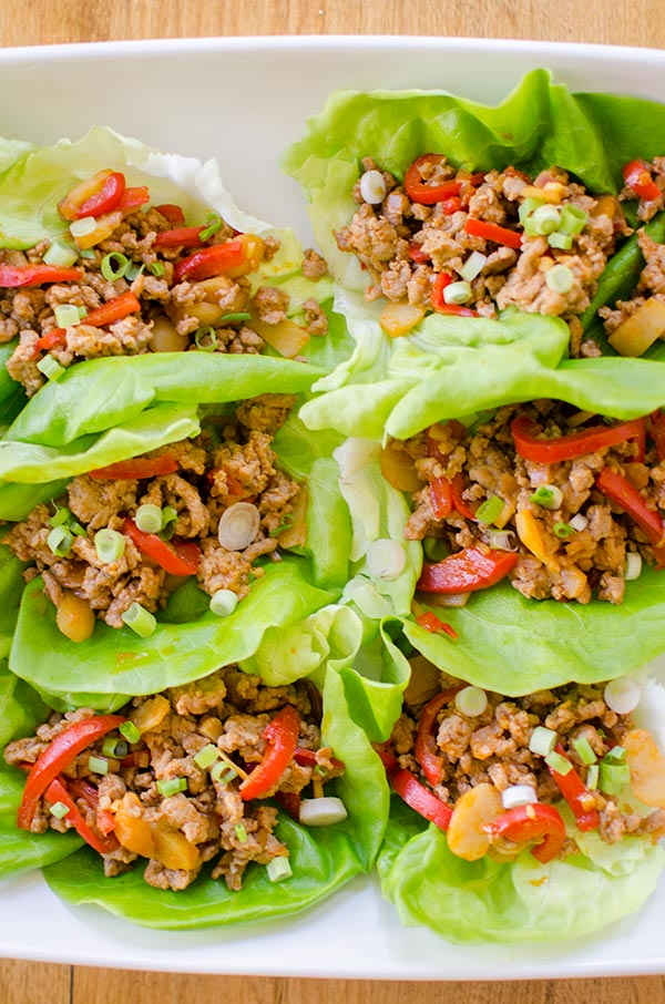 A healthy chicken lettuce wrap made with red peppers, ginger and water chestnuts. | livinglou.com
