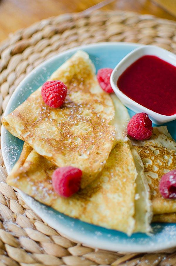 Homemade crepes with raspberry sauce. | livinglou.com