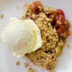 Strawberry rhubarb crisp is the perfect spring dessert with a hint of vanilla and cinnamon.   livinglou.com
