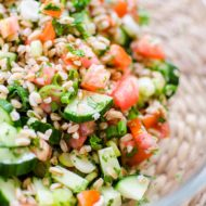 A traditional tabbouleh salad gets an update using farro for a simple and healthy farro tabbouleh salad. | livinglou.com