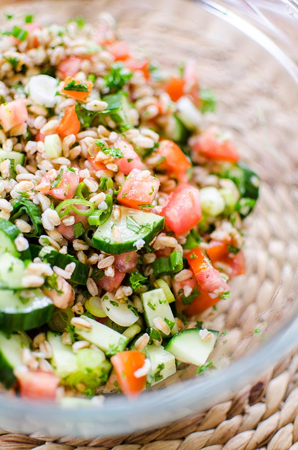A traditional tabbouleh salad gets an update using farro for a simple and healthy farro tabbouleh salad.   livinglou.com