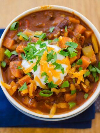 Hearty vegetarian chili with black beans, sweet potatoes, carrots, zucchini and mushrooms. | livinglou.com
